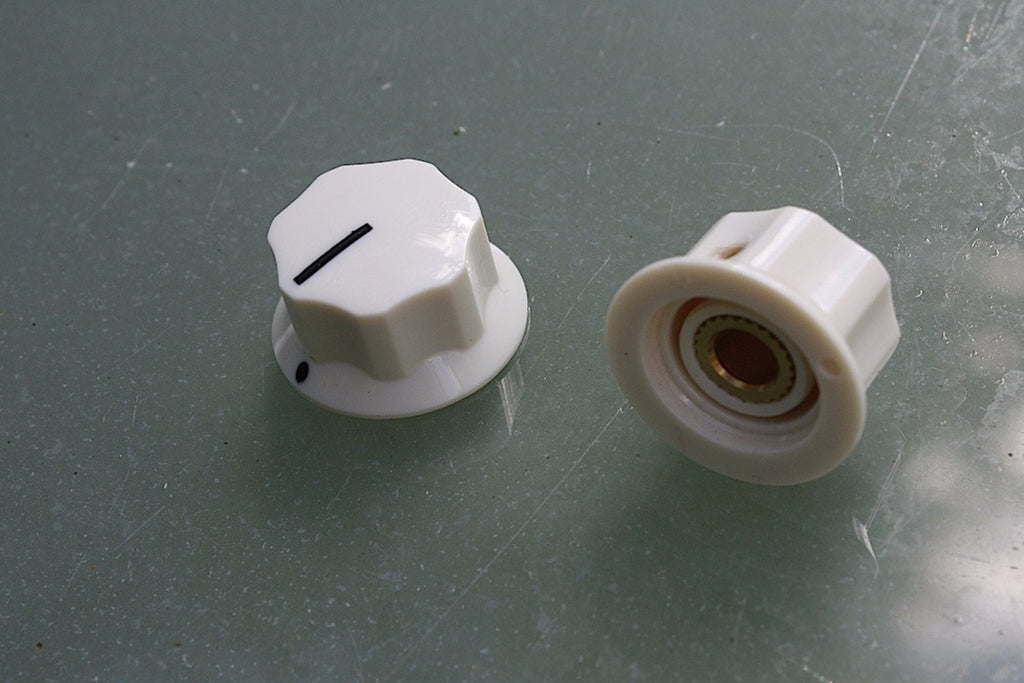 Radio-style control knobs in cream, pair.