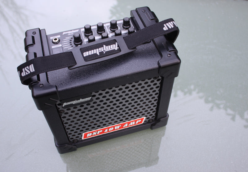TomsLine TM-05 mains/battery guitar amp. 6 AA batteries or main power. UK and EU plugs/adaptors included.
