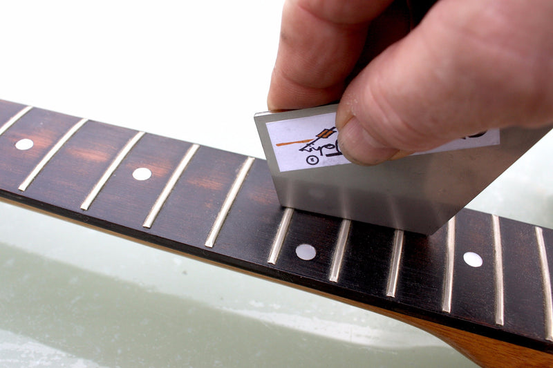 Stainless steel fret rocker to level out guitar frets.