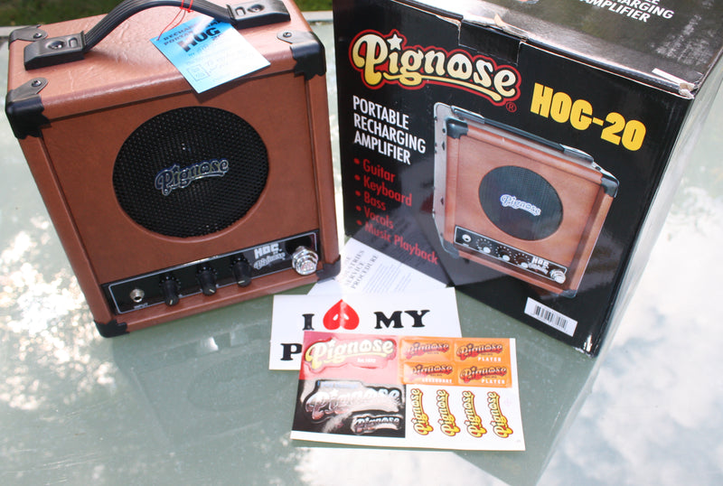 Pignose Hog 20 rechargable battery amplifier. Stickers and instructions.