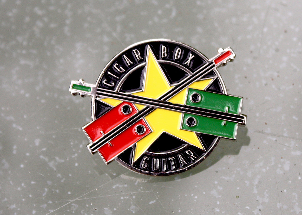 Cigar Box Guitar metal pin badge, nickel plated with coloured enamel.