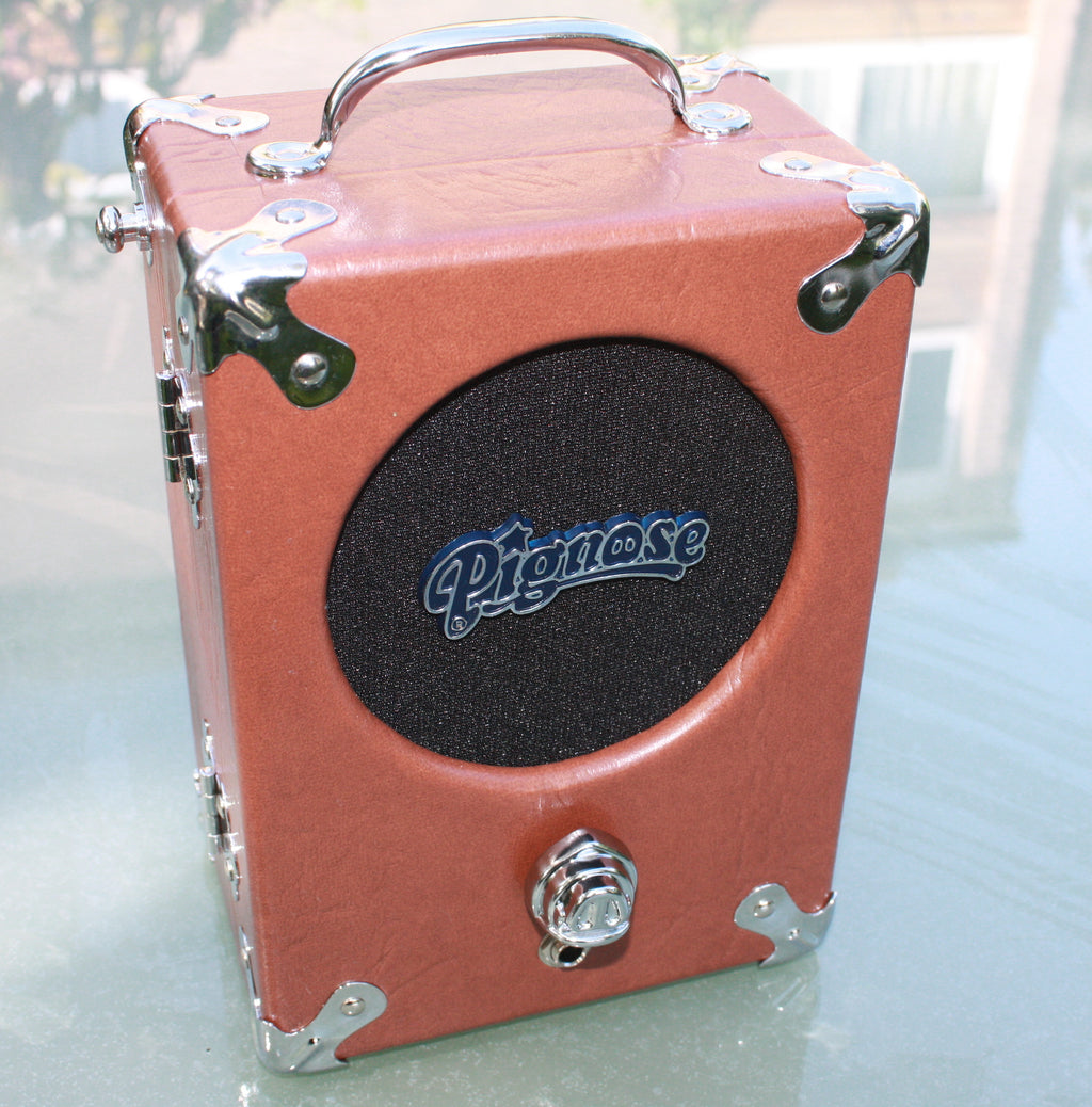 The Legendary Pignose 7-100 Battery Amplifier. Available in 3 finishes original, tweed and snakeskin.