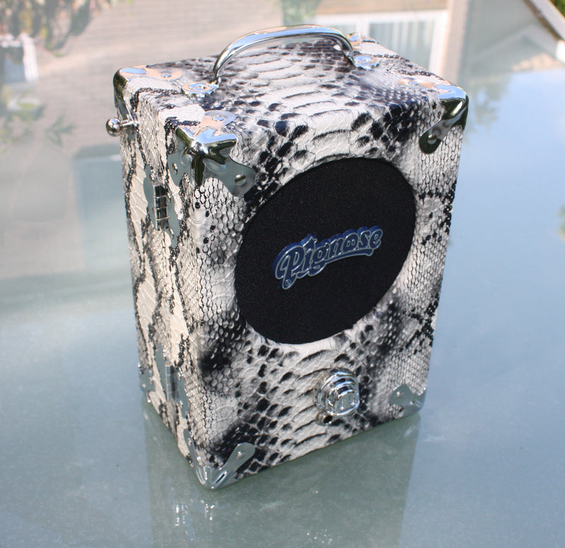 The Legendary Pignose 7-100 Battery Amplifier. Snakeskin covering, requires 6 AA batteries.
