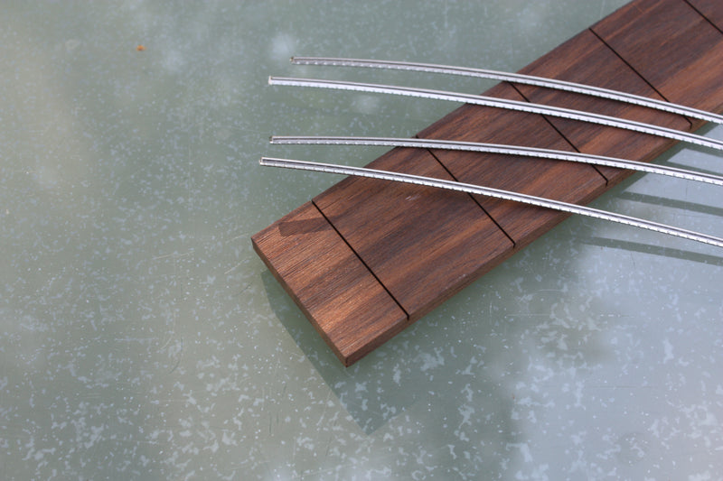 Blackwood Tek Fretboard collection, slotted with fretwire for 3 string cigar box guitars.
