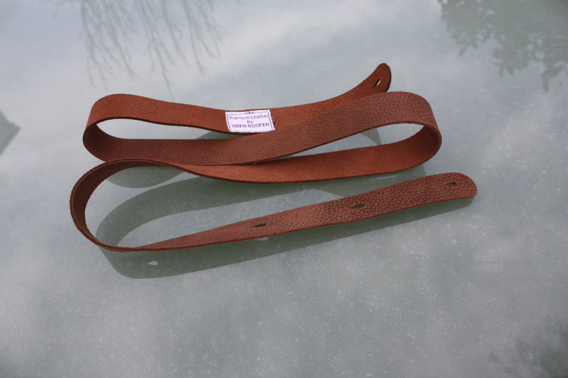 Handmade Uber Doofer Leather Guitar Strap, available plain or with a shoulder pad.