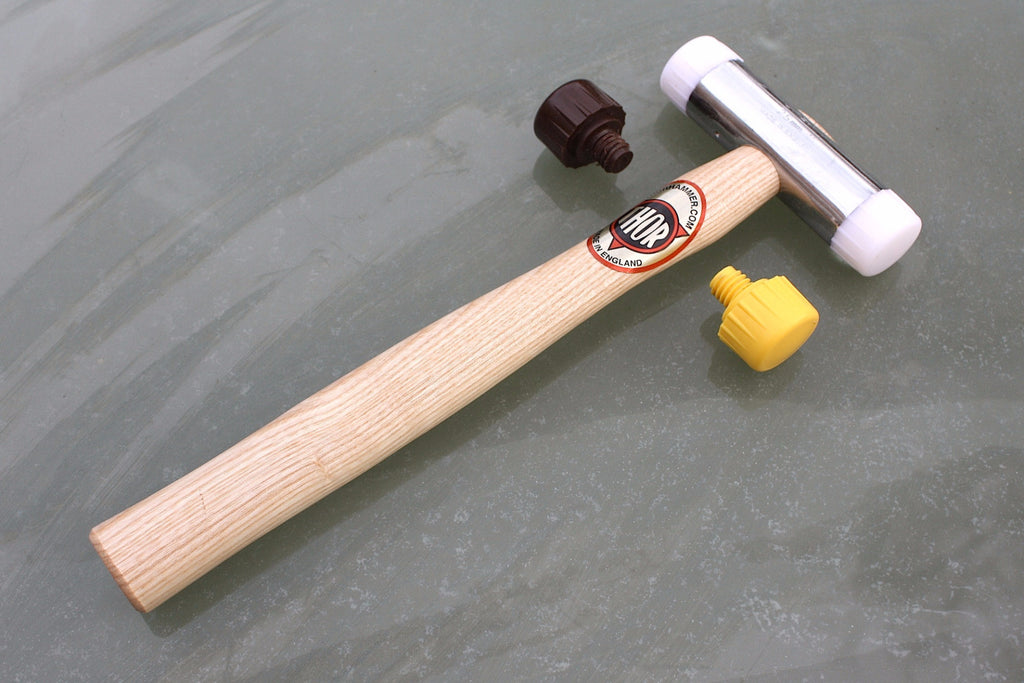 Fretting hammer by Thor, two durable non-marring nylon faces provided.