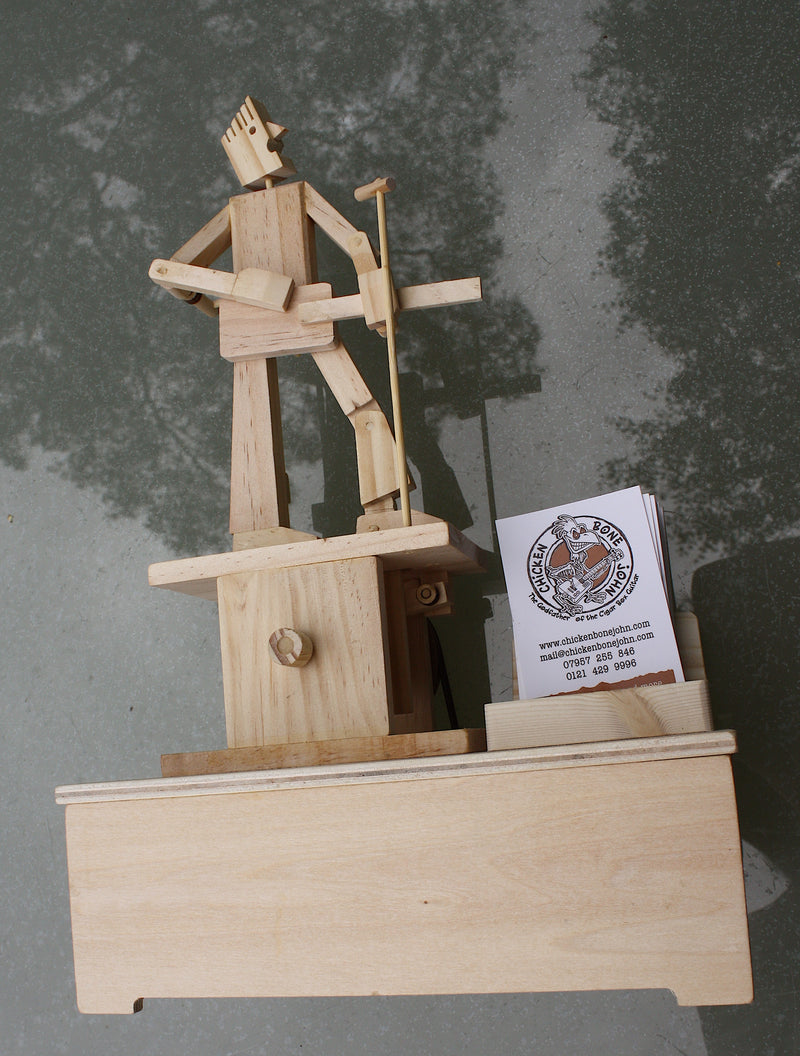 Guitar Player Timberkit Automaton fully built on battery driven base. With custom business card holder.