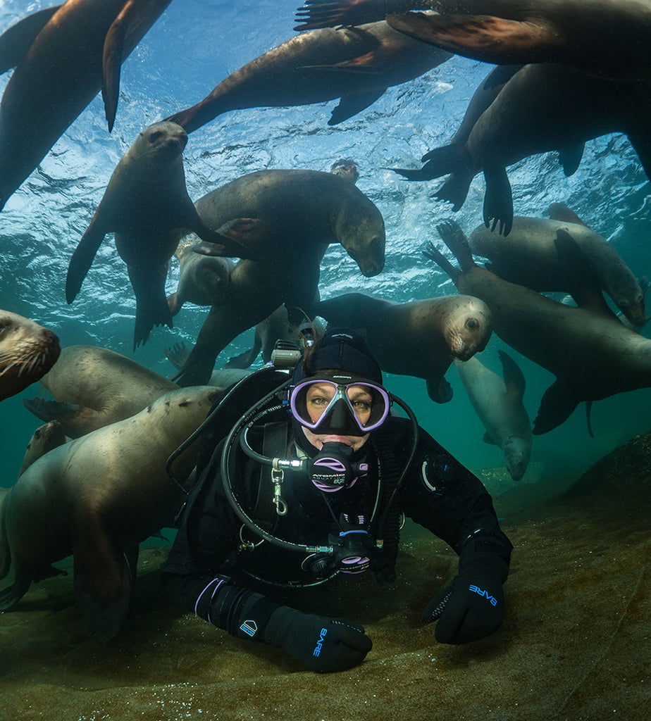 5Maxwel Hohn scuba diver surrounded by sea lions