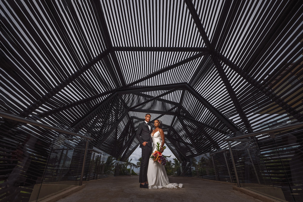 Andre Brown Photography bride and groom in black sculpture