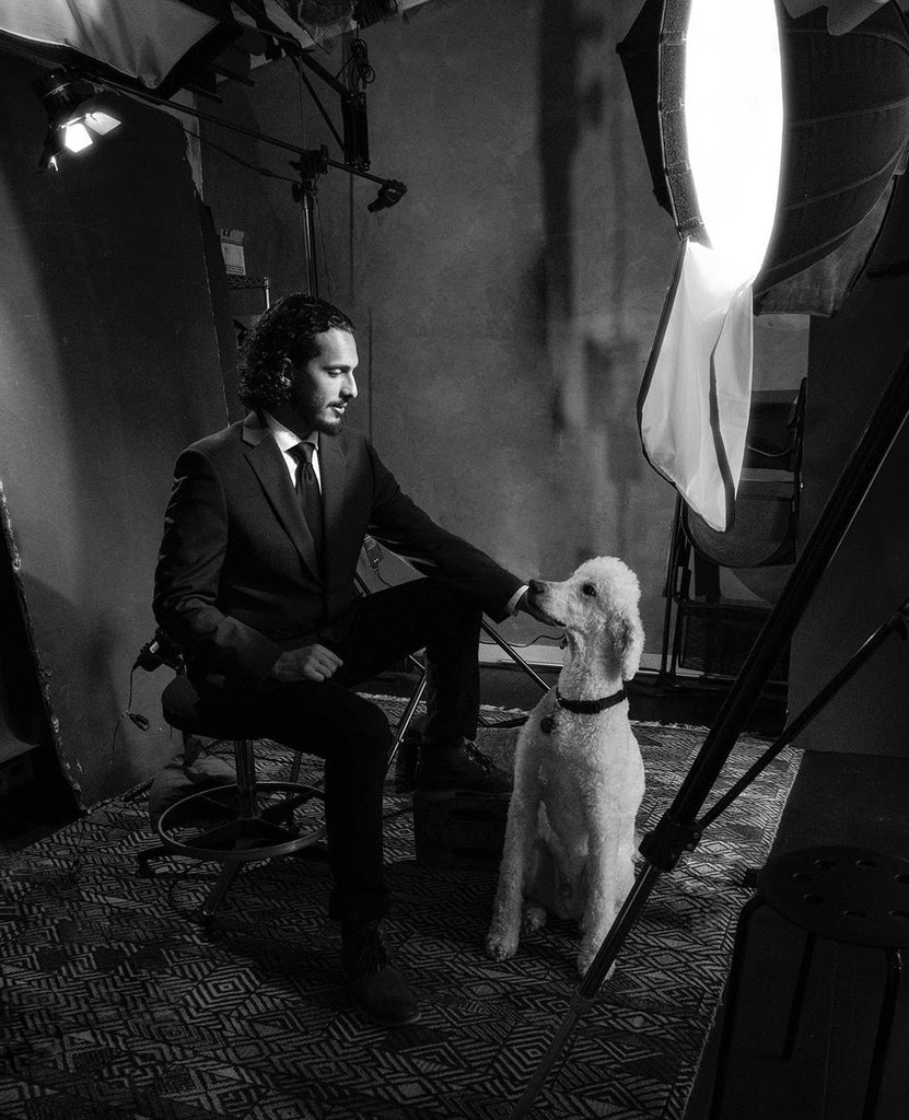 Alan Weissman portrait of man in suit with white standard poodle
