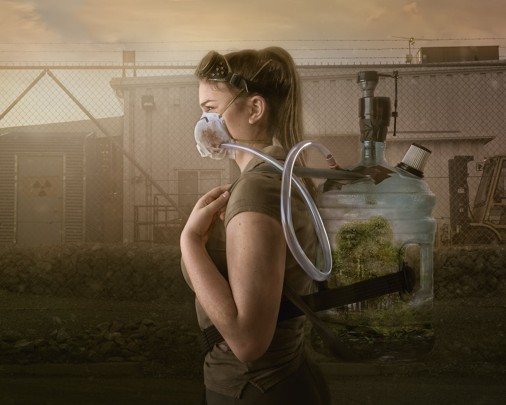 Alana Lee portrait of woman wearing mask breathing air from tank on back eye goggles