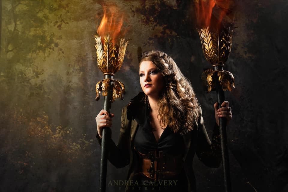 Andrea Calvery blond wavy hair woman with torches dramatic lighting