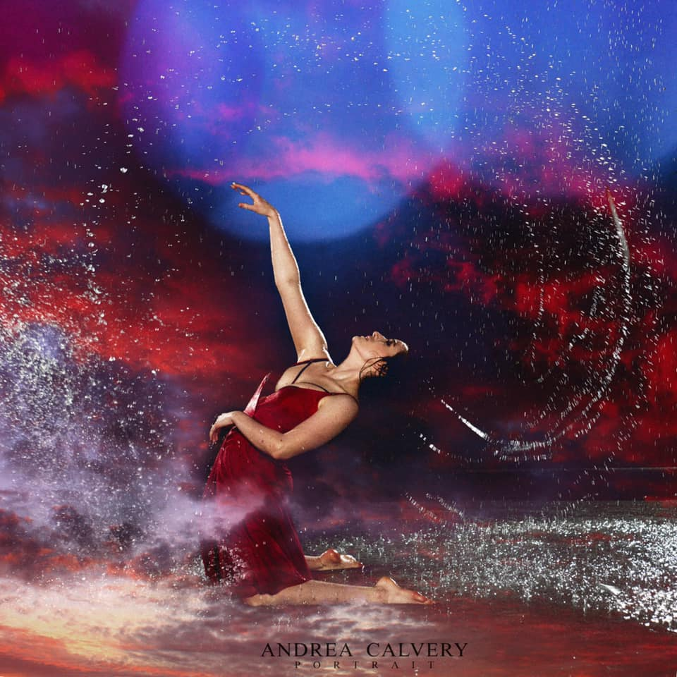 Andrea Calvery woman dancing in rain with red skies red dress dramatic lighting