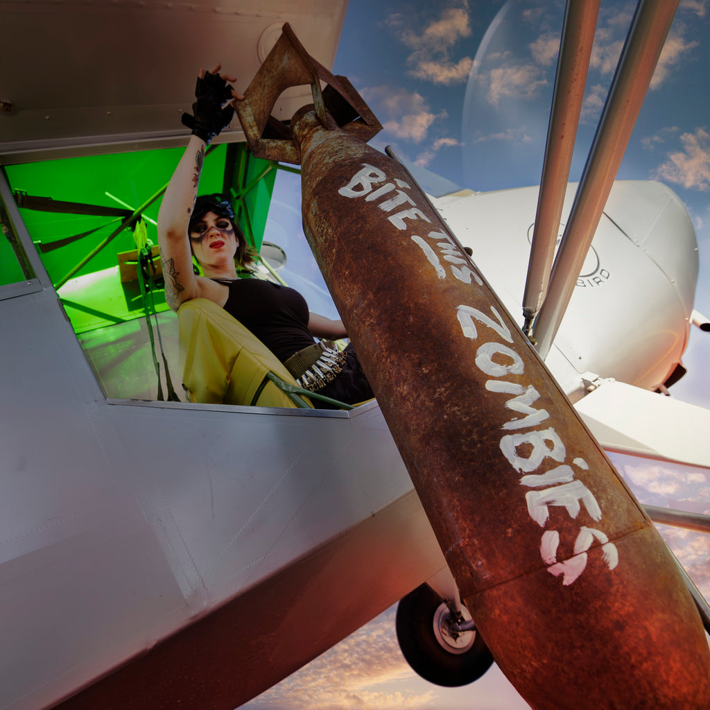 Bruce Dorn model in airplane dropping bomb bite this zombies