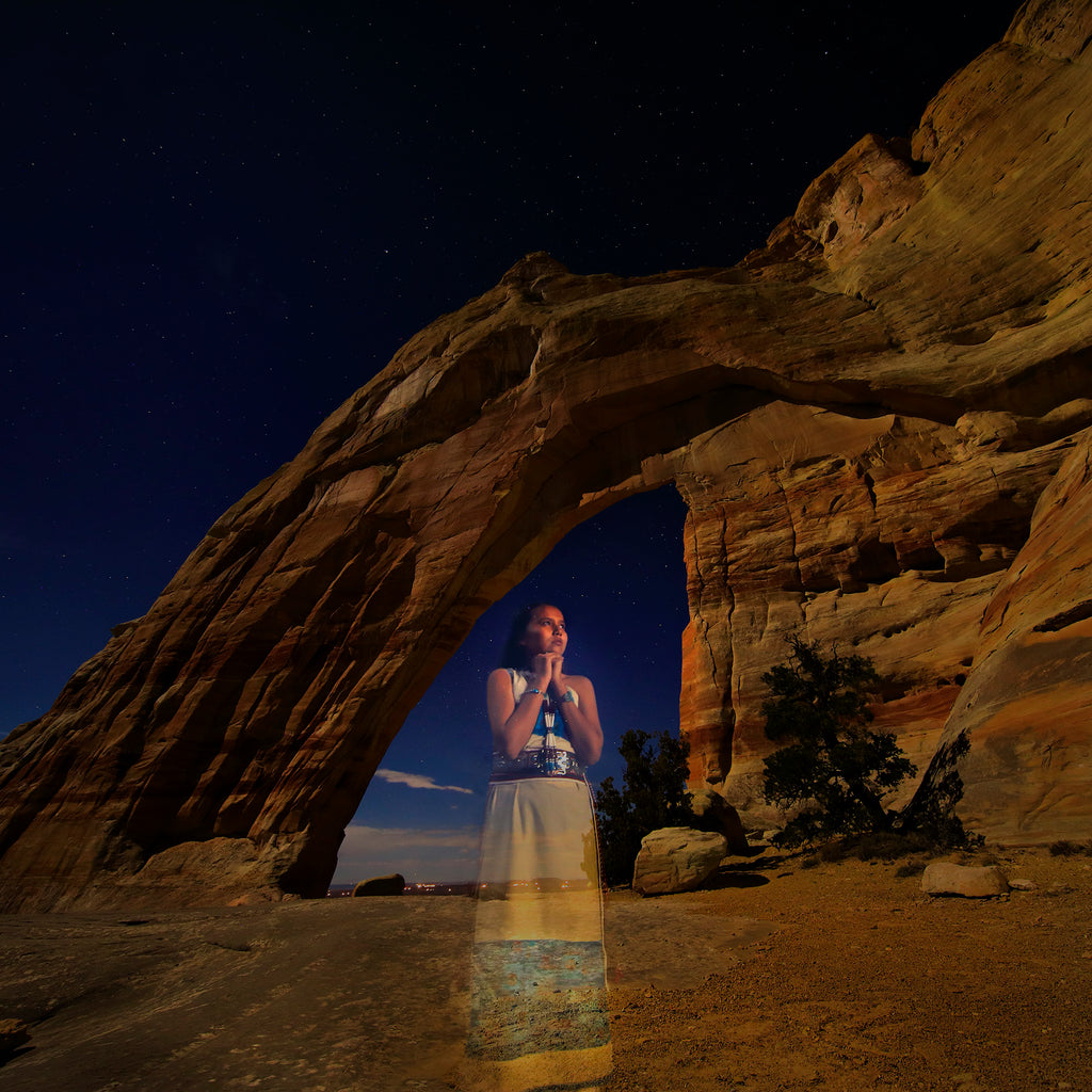 Bruce Dorn model wearing traditional native american dress super imposed under red sand archway