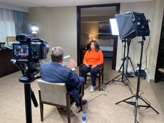 Carmaine Means indoor interview camera and lights