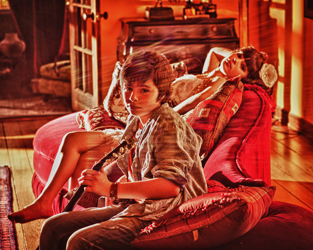 Charles Maring portrait of boy with guitar girl on couch red