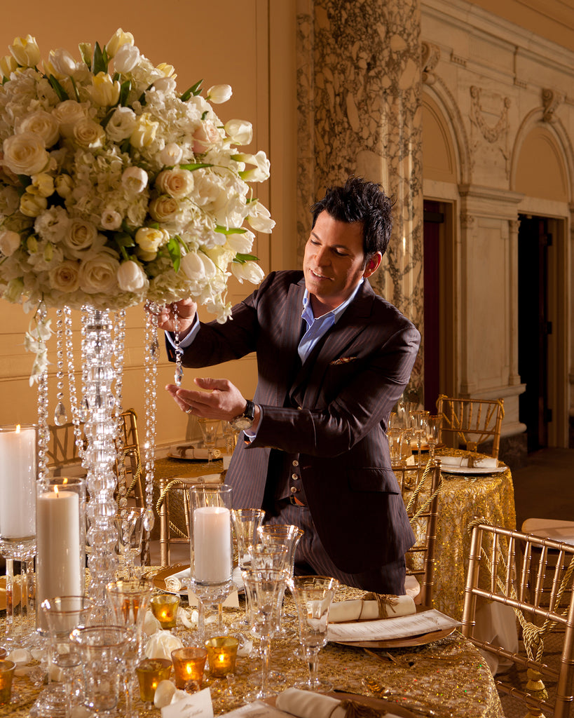 Charles Maring portrait of man wearing suit arranging flowers at wedding reception