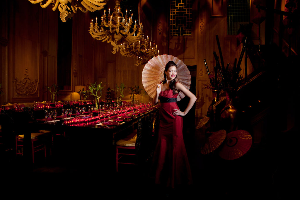 Charles Maring portrait of woman wearing red dress holding asian style umbrella parasol banquet hall reception hall