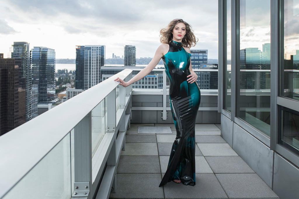 Cliff Lenderman photograph woman in blue green skin tight dress city view highrises