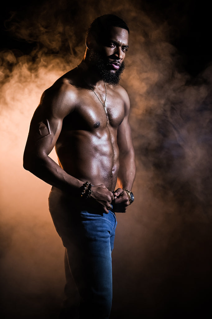 Cliff Mautner portrait of Black man with muscles wearing jeans dramatic lighting