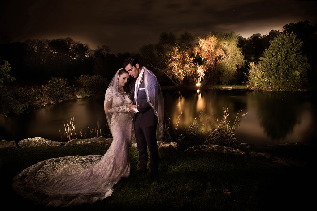 Cliff Mautner portrait of bride and groom on wedding day near pond and trees