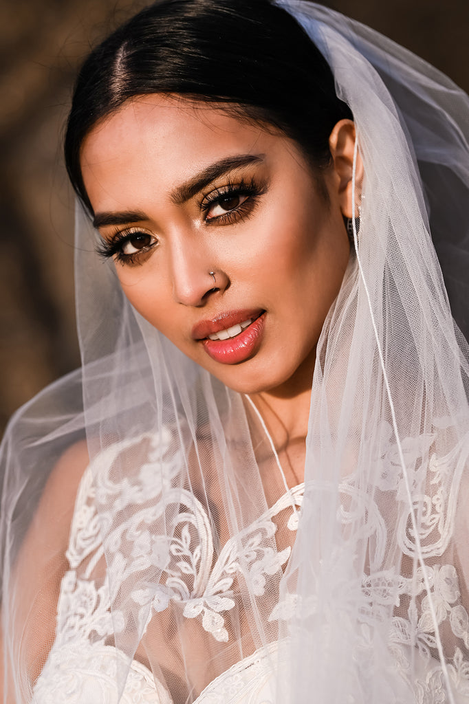 Cliff Mautner portrait of bride in wedding dress and veil lacy top dramatic outdoor lighting
