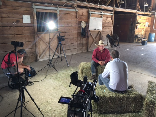 Cowboy interview in barn with hay and saddle