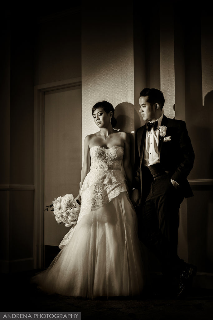 Dina Douglass portrait of bride and groom bride holding bouquet flowers black and white groom in tuxedo