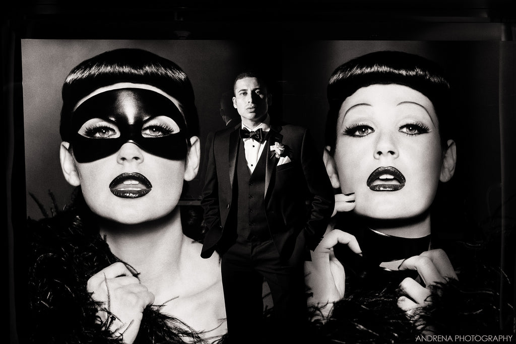Dina Douglass portrait of woman in mask and man in tuxedo black and white