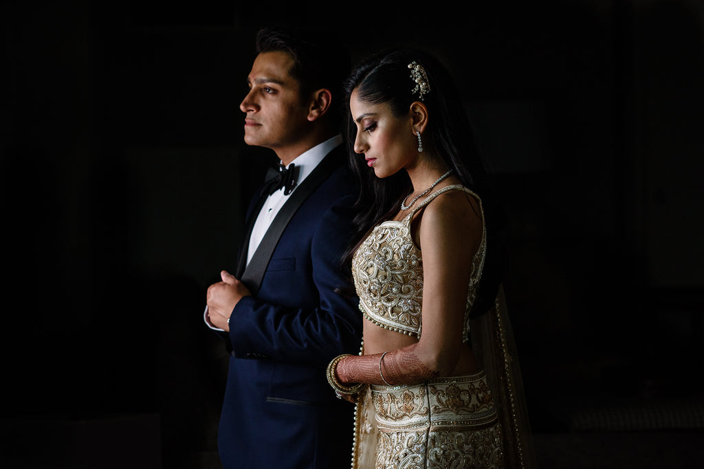 Erum Rizvi portrait of bride and groom with dark background dramati lighting