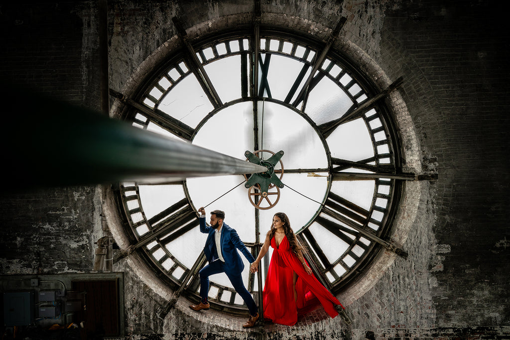 Erum Rizvi portrait of man and woman bride and groom inside of clocktower red dress blue suit