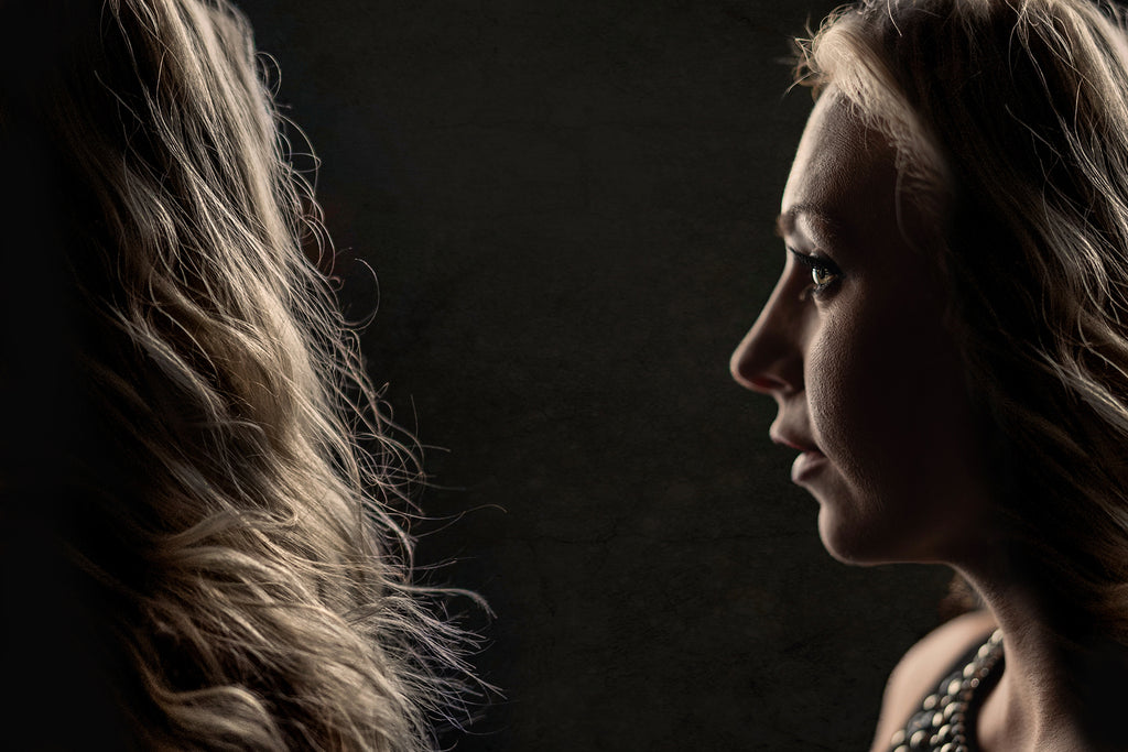 Eyenamics photograph of woman back and front of head silhouette blond hair