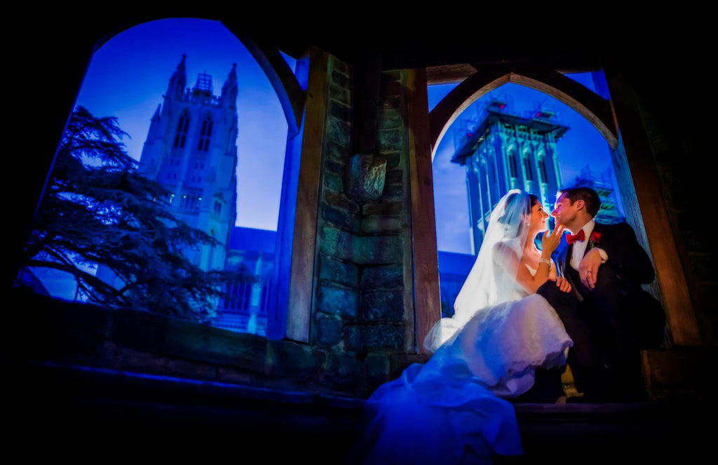 Greg Gibson bride and groom at night National Cathedral archways