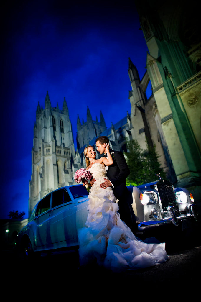 Greg Gibson bride and groom at night with Rolls Royce and National Cathedral