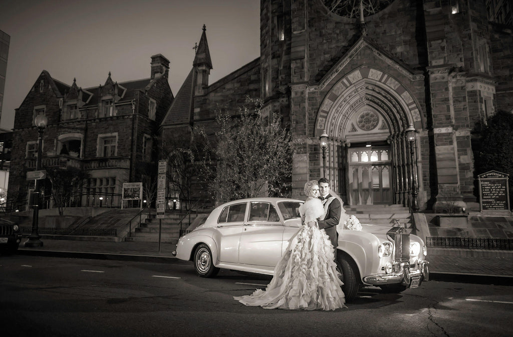 Greg Gibson bride and groom at night with Rolls Royce at St. Patrick's church