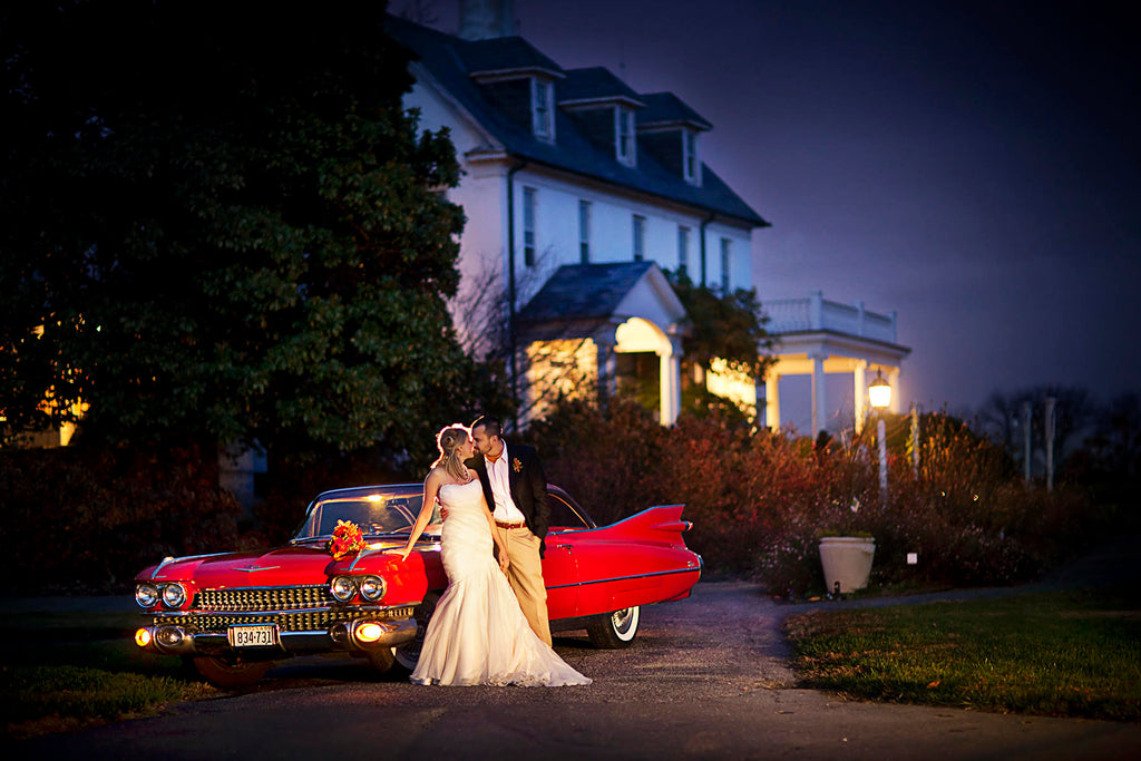 Greg Gibson bride and groom at night with red classic Cadillac