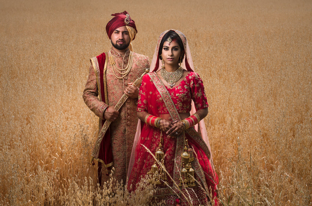 Gurvir Johal Luxury Sikh and Indian wedding bride and groom in field of grass