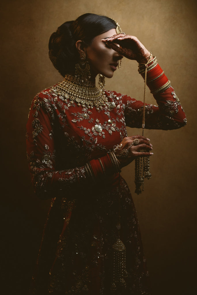 Gurvir Johal Luxury sikh and indian wedding bride wearing traditional jewelry hand on forehead