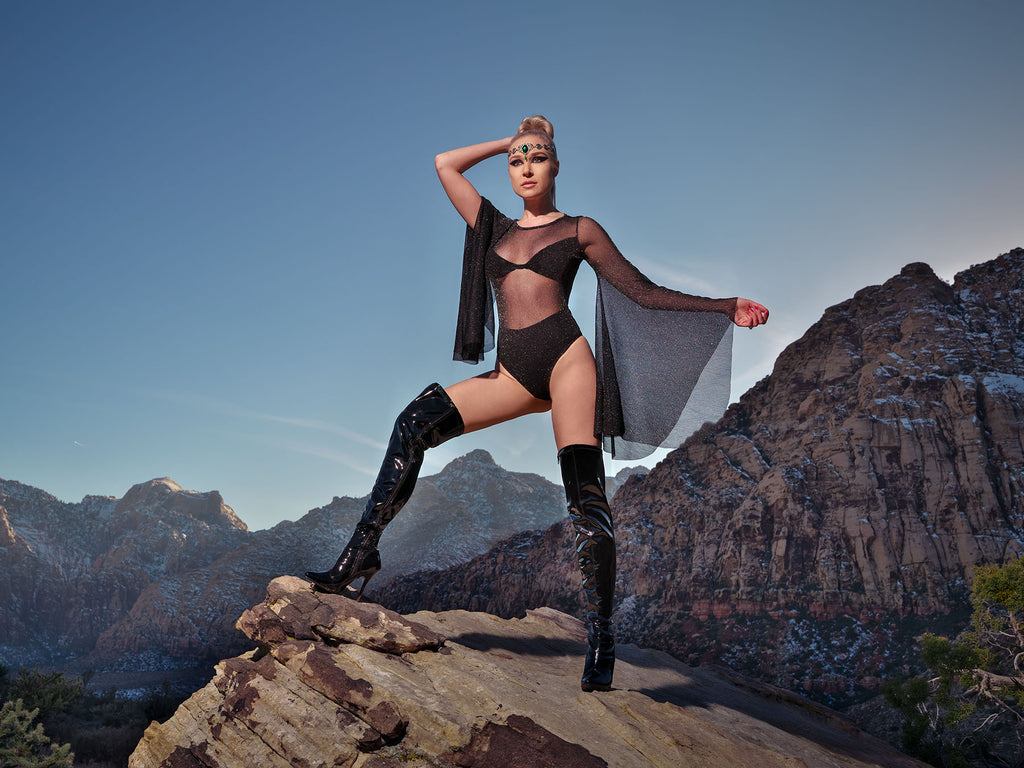 James Schmelzer Woman in black leotard and boots standing on a mountain
