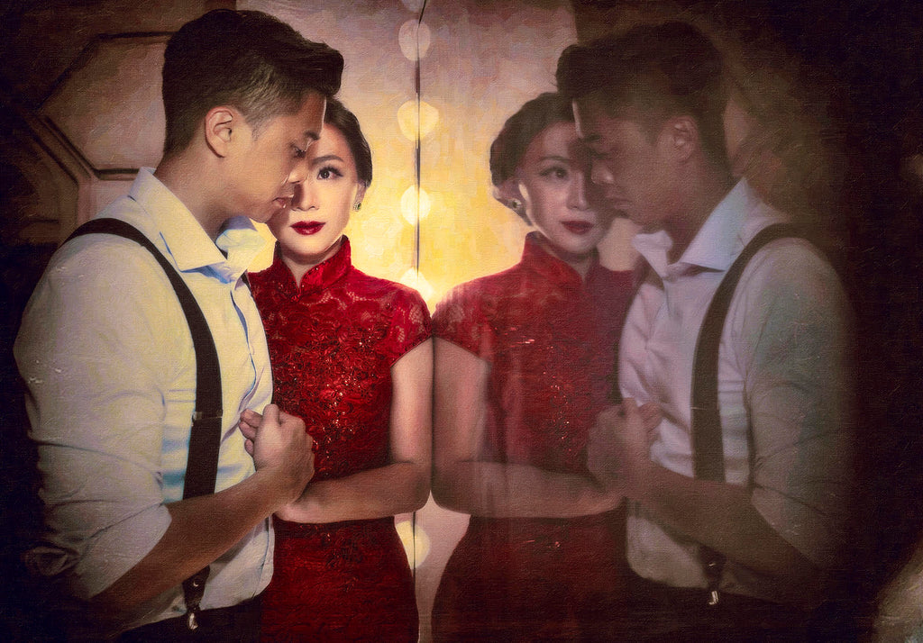 Jeremy Chan portrait of man and woman wearing red dress reflection in mirror