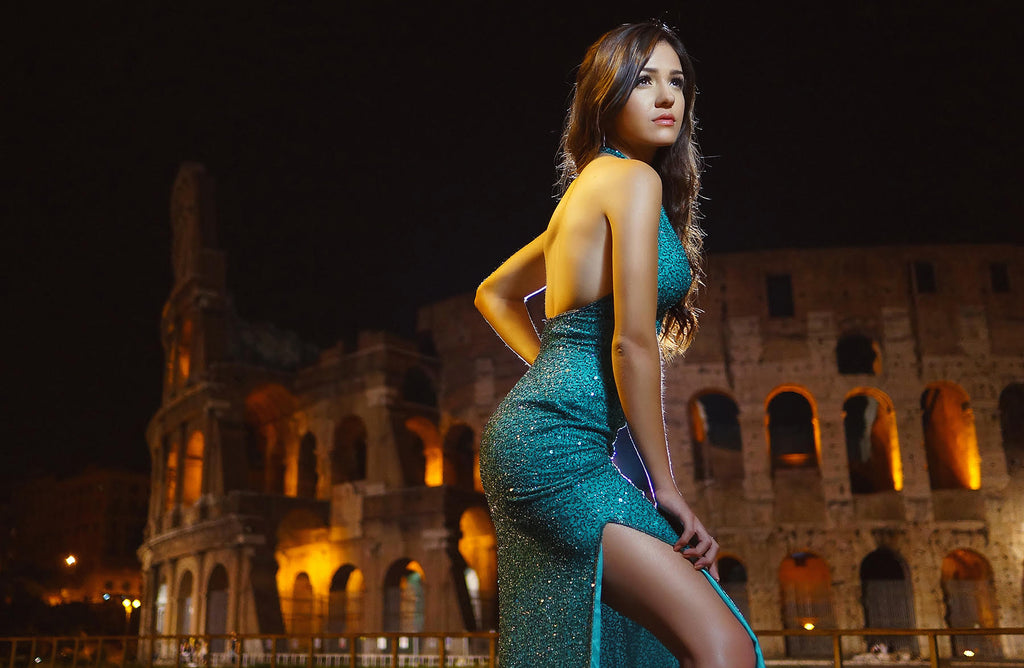 Jeremy Chan portrait of woman at night wearing green sleeveless dress with Roman Colosseum