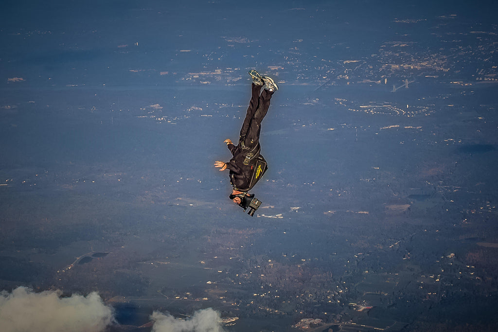 Joe Jennings image of man upside down skydiving with city in background