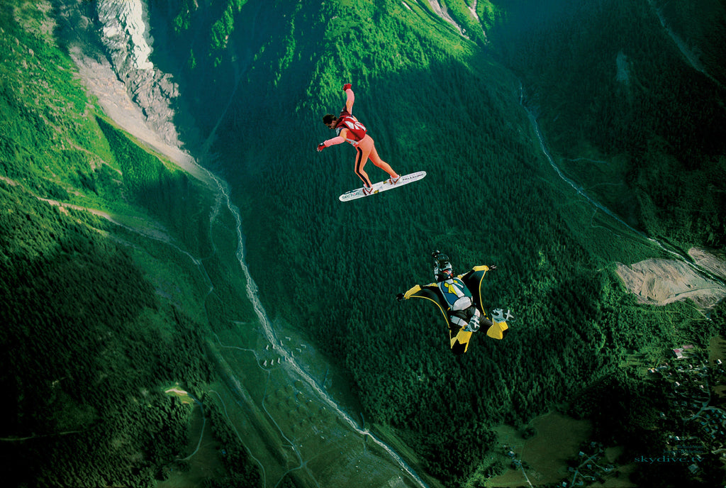 Joe Jennings image of two sky divers with green countryside in background skydiver on board skydiver in wing suit