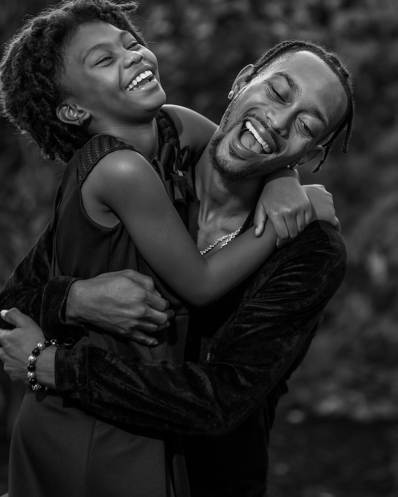Keith Cephus portrait of Black father and daughter black and white