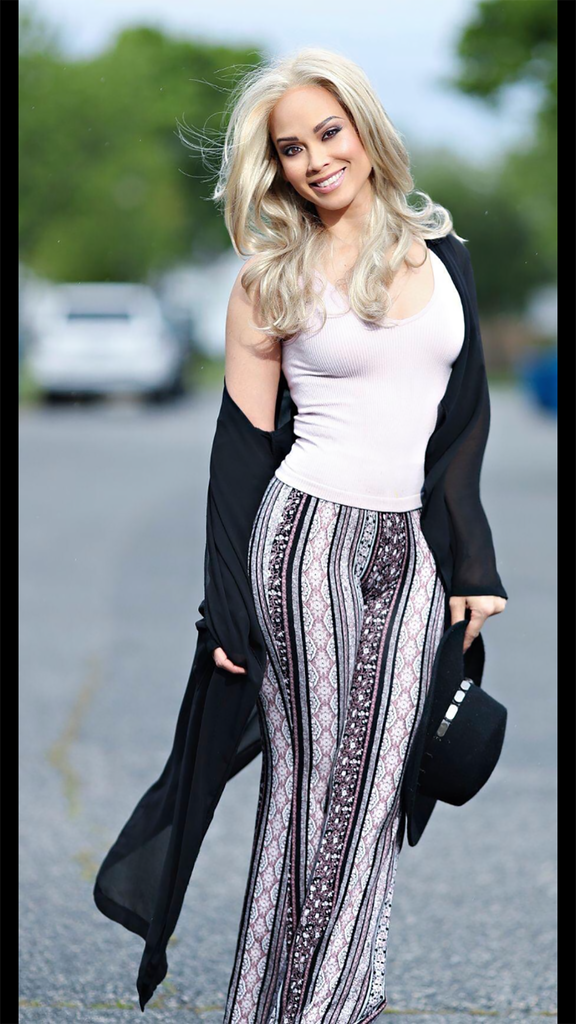 Keith Cephus portrait of blond woman wearing white top and patterned pants on street