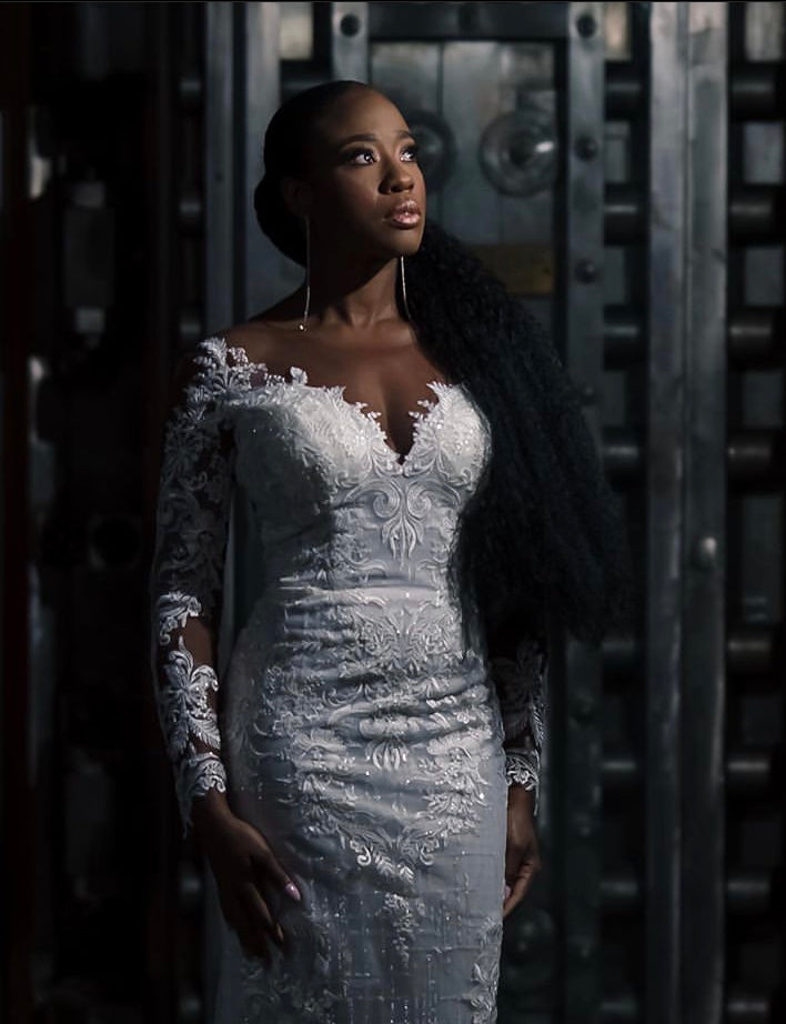 Kesha Lambert portrait of Black bride large metal doors in background