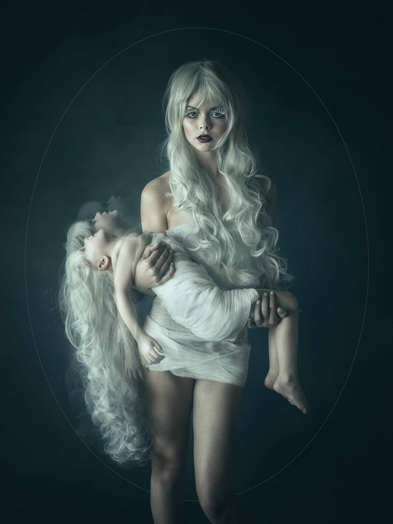 Kristi Elias photograph of woman holding child young girl white hair moody