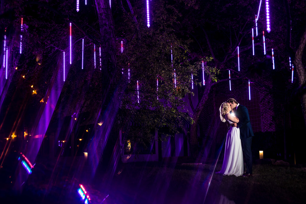 Ning Wong portrait of bride and groom on dance floor with purple twinkle lights