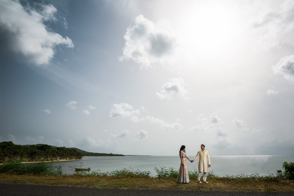Ning Wong portrait of bride and groom walking on bluff above water